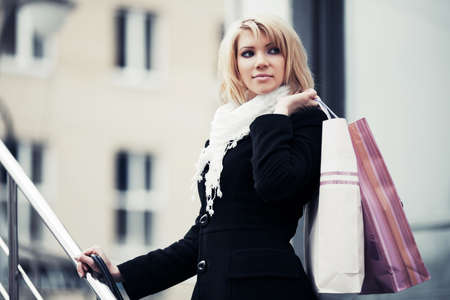 Fashion young woman with shopping bags  photo