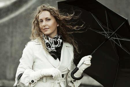 Fashion woman with umbrella in the rain  photo