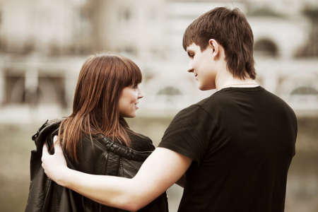 teenage love: Happy young couple in love on the city street Stock Photo