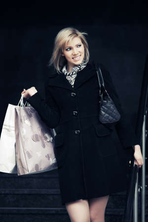 Happy young fashion woman with shopping bags  photo