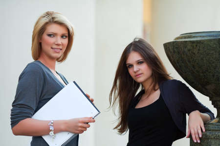 Two young female students on campus photo