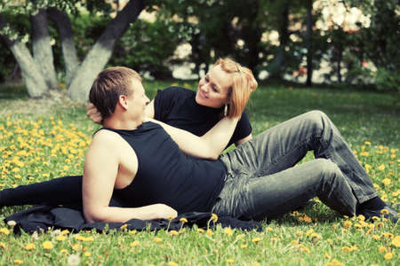 Happy young couple in a city park photo