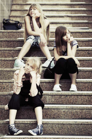 Group of school girls sitting on the steps photo