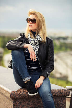 Portrait of happy young fashion woman outdoor Standard-Bild