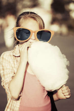 School girl eating cotton candy photo