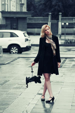 Young fashion woman with umbrella in the rain photo
