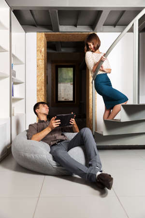 Young couple flirting in office photo