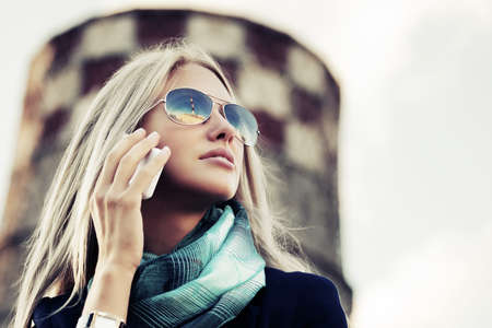 Blond fashion woman calling on cell phone photo