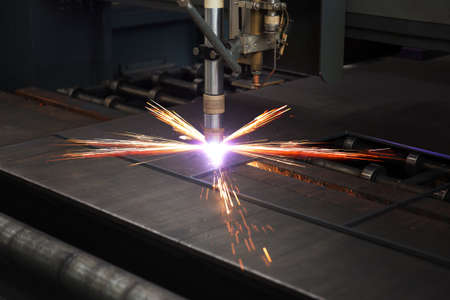 Industrial cnc plasma cutting of metal plate photo