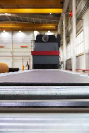 blasting: Shot blasting machine for processing of metal plates and profiles Stock Photo