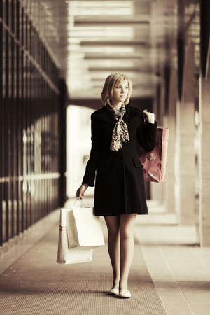 Young fashion woman with shopping bags in the mall photo