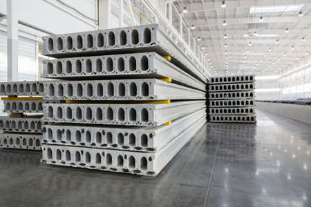 housebuilding: Stack of precast reinforced concrete slabs in a house-building factory workshop
