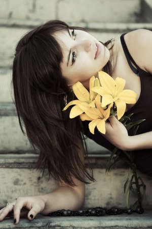 daydreaming: Happy young woman with a flowers daydreaming