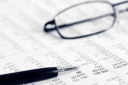 paper and pen: Financial accounting Stock Photo