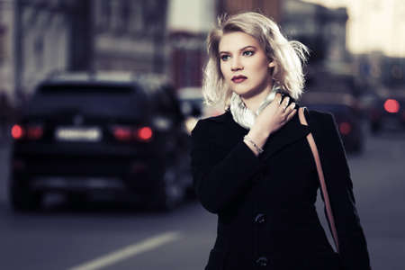 beautiful sad: Young fashion woman walking on the city street Stock Photo