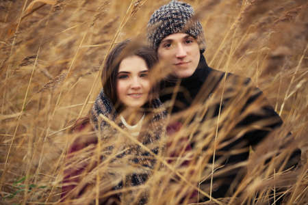 male and female: Happy young fashion couple walking outdoor