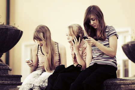 group of teens: Group of school girls calling on the cell phones
