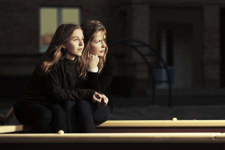 color model: Two happy teen girls on the playground