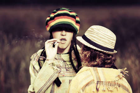 rasta hat: Young fashion hippie couple walking on nature