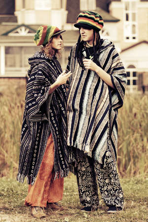 rasta hat: Young fashion hippie couple walking outdoor Stock Photo