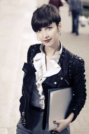 file clerks: Young fashion business woman with a folders