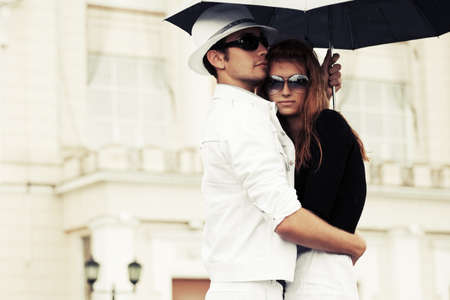 couple in rain: Young fashion couple in love with umbrella