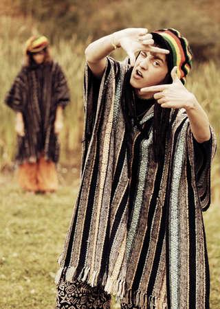 rasta hat: Young crazy fashion man walking on nature Stock Photo