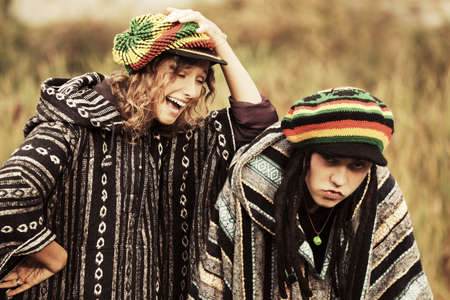 rasta hat: Young crazy fashion couple walking on nature