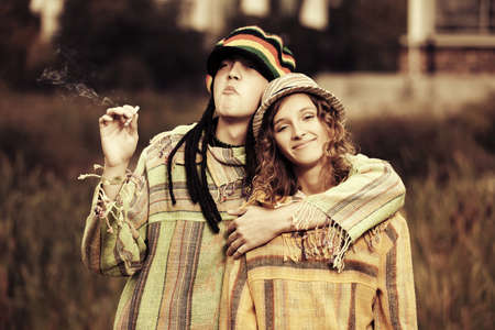 rasta hat: Young fashion hippie couple in love walking outdoor