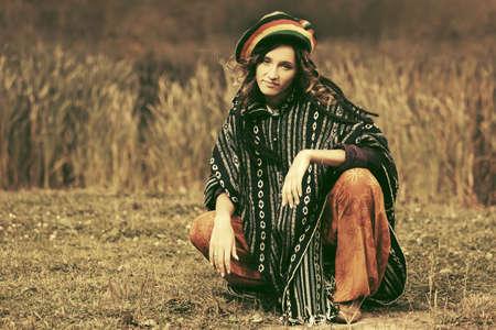 rasta hat: Young fashion rasta woman walking outdoor Stock Photo