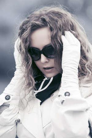 Sad beautiful fashion woman in despair walking outdoor Stock Photo