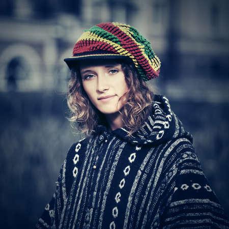 rasta hat: Young fashion hippie woman walking outdoor