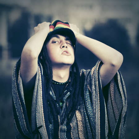 rasta hat: Crazy young fashion hippie man walking outdoor