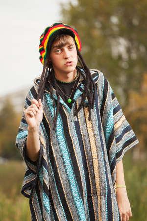 rasta hat: Sad young fashion hippie man walking outdoor