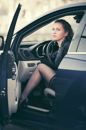 Beautiful stylish fashion woman sitting in a car outdoor photo