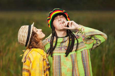 rasta hat: Young fashion hippie couple walking outdoor Stock Photo