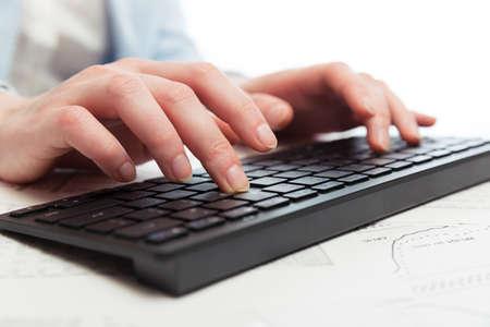 Business woman using computer keyboard