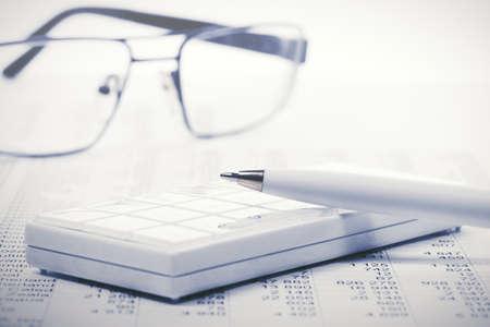 Financial accounting. Pen and calculator on balance sheets Archivio Fotografico