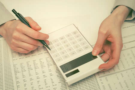 Financial accounting business woman using calculator in office Archivio Fotografico - 142551432