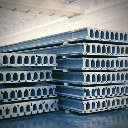 Stack of precast reinforced concrete slabs in a house-building factory workshop Stock Photo