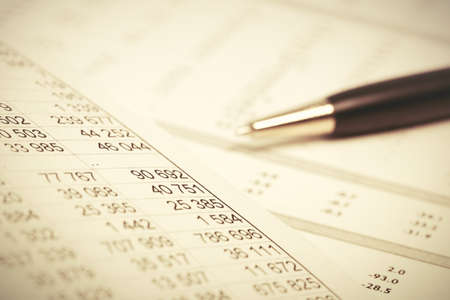 Financial accounting Pen on balance sheets Archivio Fotografico