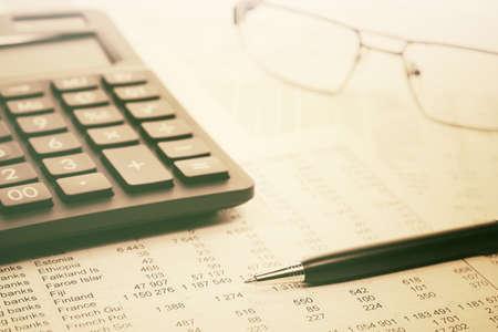Financial accounting Pen and calculator on balance sheets Archivio Fotografico