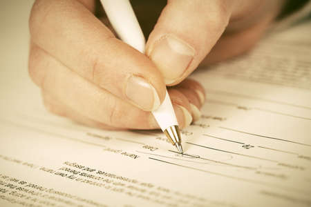 Business woman signing contract Archivio Fotografico