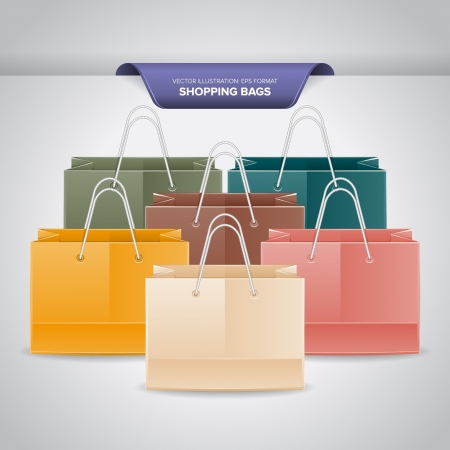 A bunch of colorful shopping bags on white background