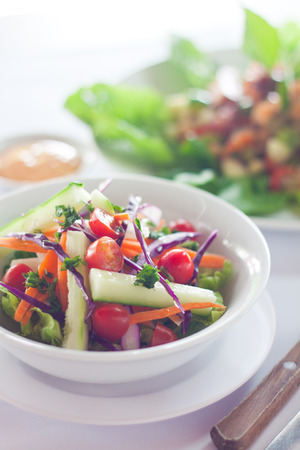 A bowl of farm fresh garden salad served with thousand island sauce