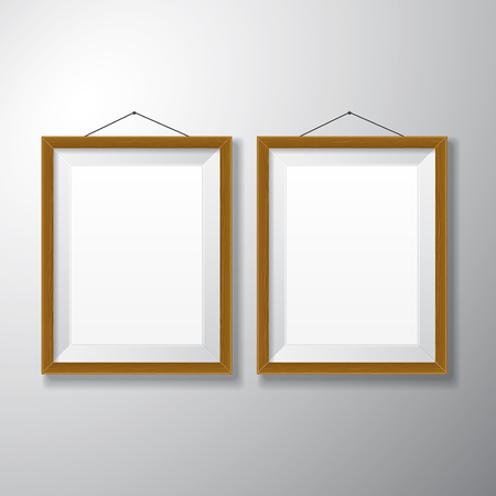 Realistic vertical wooden picture frames with empty space isolated on white background for presentation and showcasing purposes