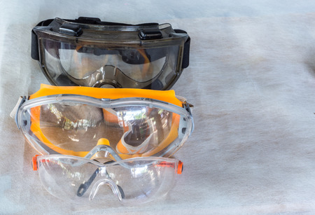 goggle and glasses for eye protection on gray background