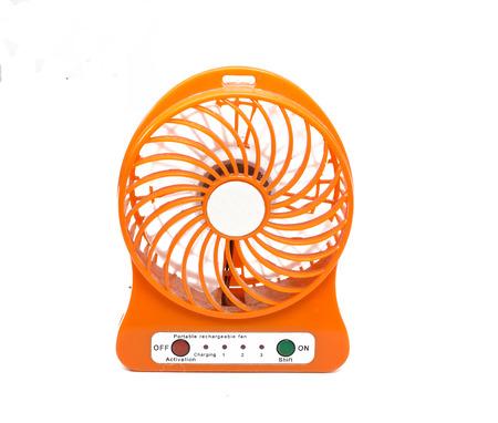small orange plastic fan on white background