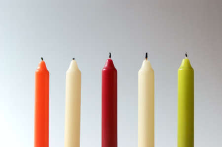 Colourful candles in line  Stock Photo