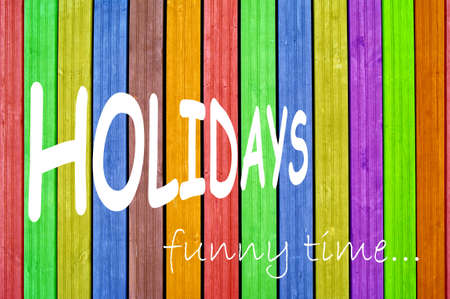 Inscription holidays on colourful background, colourful fence, colourful boards  Stock Photo